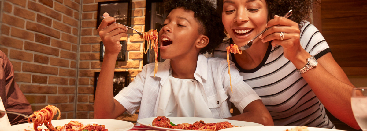girl eating pizza on carnival cruise ship